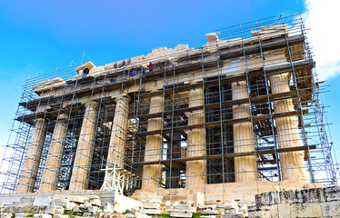 Workers up high on scaffoling for restoration work on the ancient Parthenon on the Accropolis in Athens Greece 1 - 3 - 2018