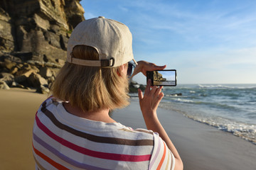 Woman takes a picture on the smartphone