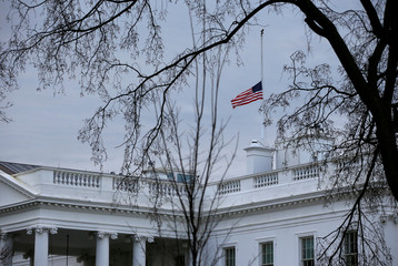 The American flag above the White House is lowered to half staff following the deadly school shooting in Parkland, FL