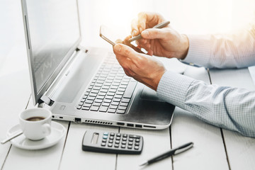 businessman working on laptop and smartphone