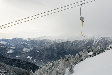landscape: cableway lift, skilift, used by skiers to have a pass at top of mountains to get off ski slopes, resort after a snowfall, Alps, Vigezzo Valley, Piedmont, Italy