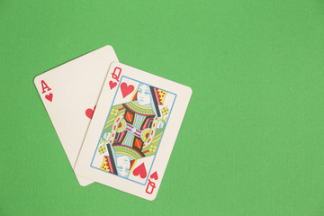 Ace and queen of hearts suited cards