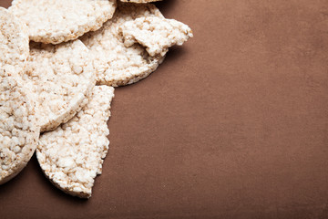 Vegetarian rice crispy biscuits on a brown vintage background, empty space for text.