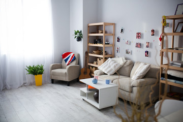 Light interior with big window and comfortable furniture.
