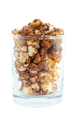 Chocolate popcorn in a transparent glass isolated on white