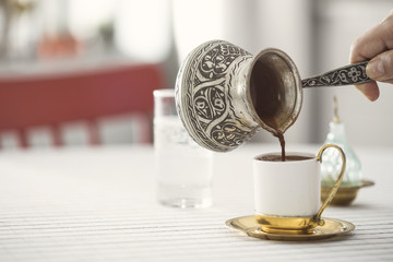 Traditional Turkish coffee with copper coffee pot