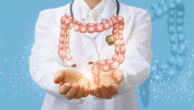 Doctor supports the colon of a person .
