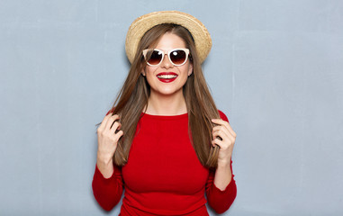 Smiling woman fashion hipster style portrait wearing in red.