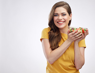 Smiling girl holding bowl with healthy  green food salad.