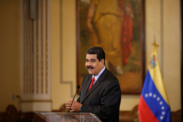 Venezuela's President Nicolas Maduro smiles during a news conference in Caracas