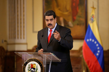 Venezuela's President Nicolas Maduro gestures as he talks to the media during a news conference in Caracas