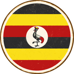 Vintage Metal Sign - Uganda Round Flag - Vector EPS10. Grunge scratches and stain effects can be easily removed for a cleaner look.
