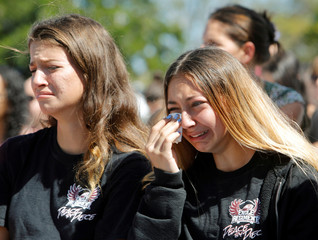 Students mourn during a community prayer vigil at Parkridge Church in Pompano Beach