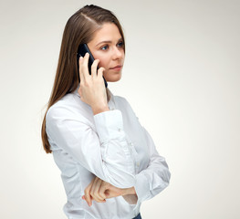 Woman talking with mobile phone. Isolated portrait