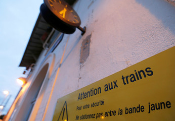A warning sign is seen at the French state-owned railway company SNCF station of Castelnau d'Estretefonds