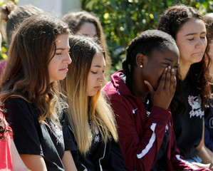 Students mourn at a community prayer vigil at Parkridge Church in Pompano Beach