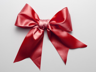 Red Ribbon Bow with Real Shadow isolated on White Background