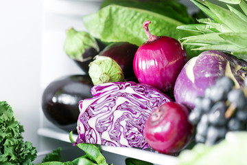Purple fresh vegetables in refrigerator