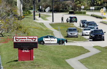 A message about grief counseling appears on an electronic signboard at Marjory Stoneman Douglas High School in Parkland