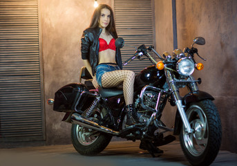 beautiful young girl on a motorcycle