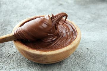Homemade hazelnut spread in wooden bowl. Hazelnut Nougat cream