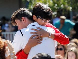 Students from Marjory Stoneman Douglas High School attend a memorial following a school shooting in Parkland