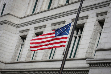 The U.S. flag flies at half-mast, in response to the shooting at the Marjory Stoneman Douglas High School in Parkland, Florida, outside the Federal Office building in Brooklyn, New York
