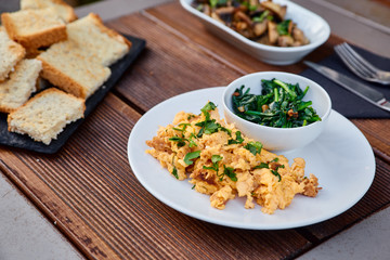Snack from grated beans and greens, served with chopped mushrooms and seasoning, as well as slices of roasted homemade bread. Snack puree from legumes for spreading on toast.