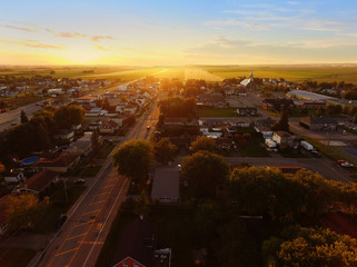 Aerial view of sunset on a small town Fotomurales