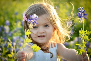Beautiful little girl in a field of bluebonnets