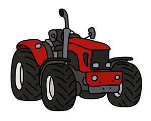 The red open heavy tractor