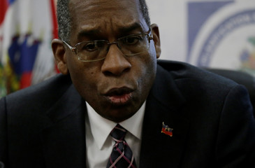 Haitian Minister of Foreign Affairs Antonio Rodrigue speaks during a news conference about the Oxfam scandal at the offices of Planning and Foreign Cooperation Ministry in Port-au-Prince