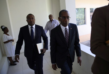 Haitian Minister of Foreign Affairs Antonio Rodrigue leaves after a news conference about the Oxfam scandal at the offices of Planning and Foreign Cooperation Ministry in Port-au-Prince