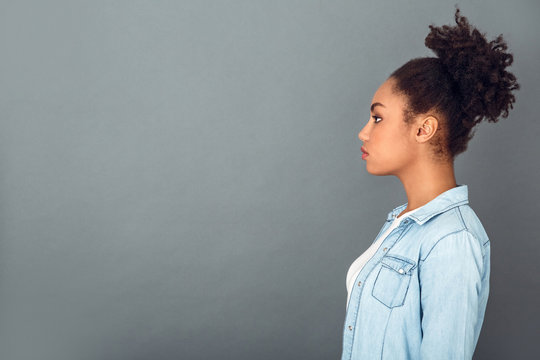 Young african woman isolated on grey wall studio casual daily lifestyle profile
