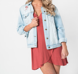 Beautiful Woman in a Distressed Denim Jacket and Red Dress - Close up