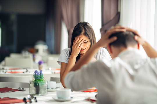 Crying stressed woman arguing with a man about problems.Reaction to negative event,handling bad news.Breaking up long relationship.Emotional troubled woman expression.Couple fighting.Emotional pain