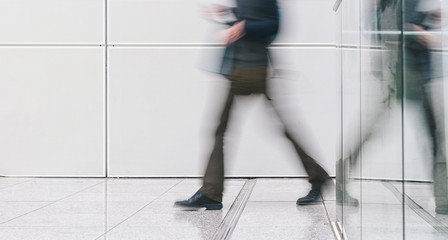 anonymous people rushing in a corridor