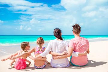 Happy beautiful family on white beach