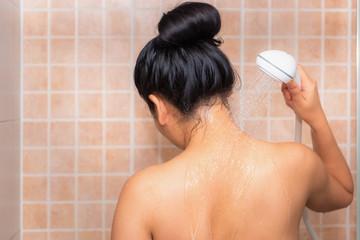 Portrait of beautiful woman taking shower in bathroom