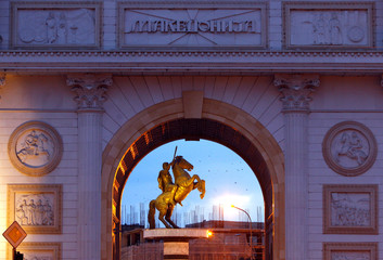 The Warrior on horse monument is seen trough the Triumphal Gate at Macedonia Square in Skopje