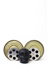 film reels of old movies and black dummy head