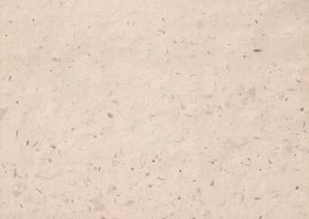 texture of kraft paper sheet with dark brown grain shavings