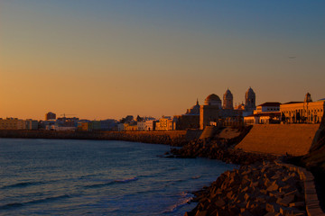 Seafront. Embankment and sea view in Cádiz. Sunset.