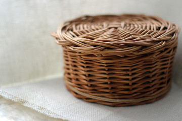 Wicker basket with lid on white background.