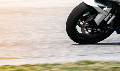 Big bikes are running at high speeds, focusing on the front wheels.