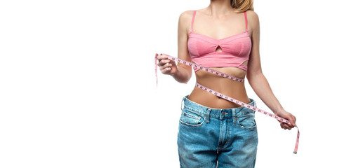 Woman is measuring waist after weight loss on white background