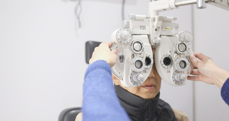 Senior man doing eye test