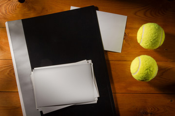 Folder with photos with tennis balls
