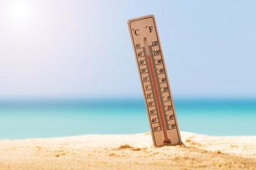 Obraz Close-up Of Thermometer On Sand - fototapety do salonu