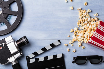 Spilled Popcorn With Clapperboard And Movie Camera